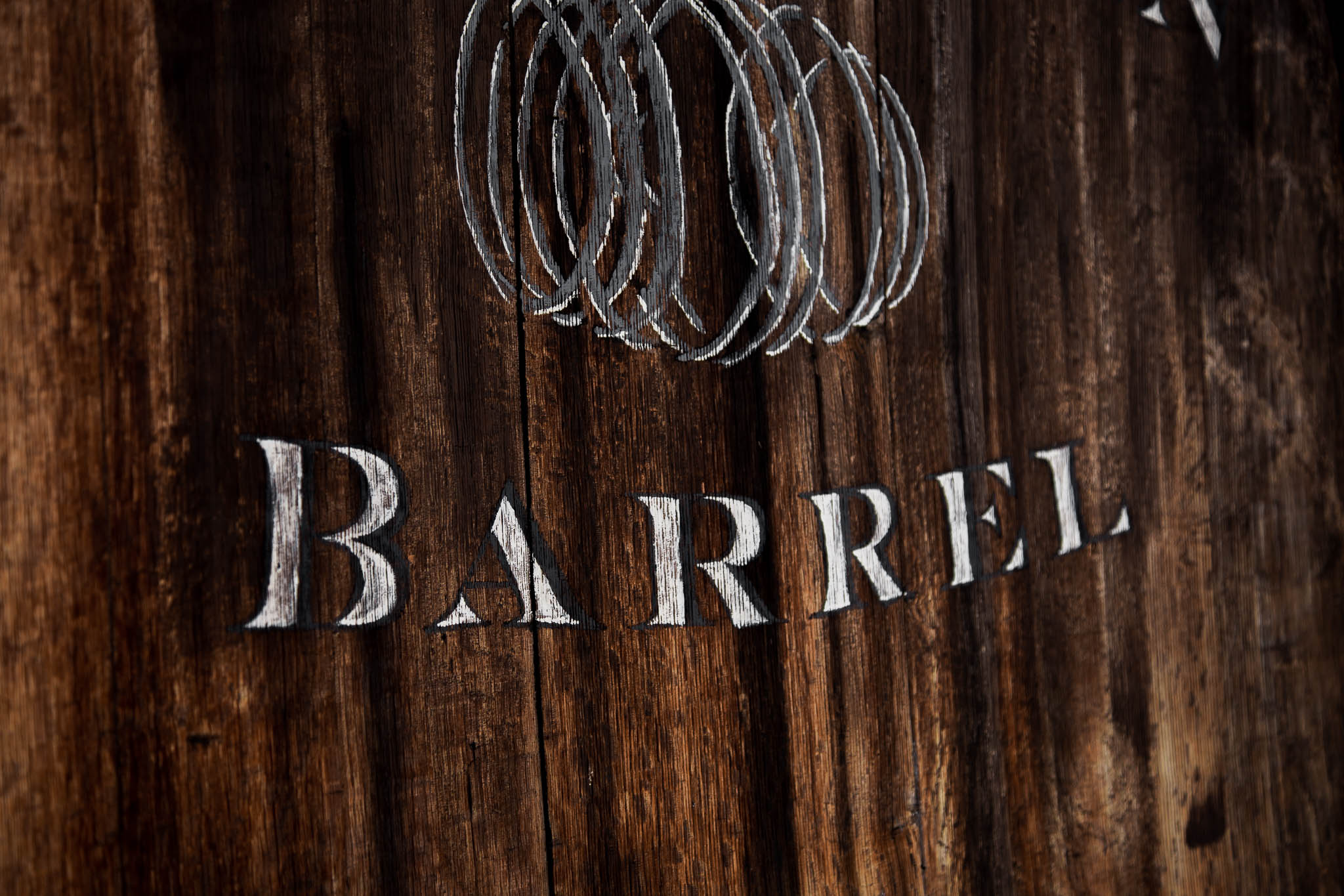 Handpainted, Hand Lettered Signage for Winery Branding on Historic Winery Barrel by Amarie Design Co.